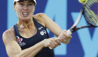 **FILE** Washington Kastles' Martina Hingis hits a backhand to Texas Wild's Eugenie Bouchard during their World Team Tennis singles match Friday, July 19, 2013, in Irving, Texas. (AP Photo/Kim Johnson Flodin)