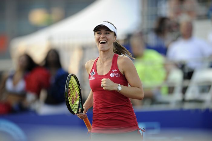 **FILE** Washington Kastles' Martina Hingis, of Switzerland, reacts during a World Team Tennis women's doubles match against the Boston Lobsters, Tuesday, July 9, 2013, in Washington. (AP Photo/Nick Wass)