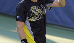 Mardy Fish reacts during his match against Matthew Ebden, from Australia, at the Citi Open tennis tournament, Monday, July 29, 2013 in Washington. Fish won 2-6, 6-1, 6-3. (AP Photo/Alex Brandon)