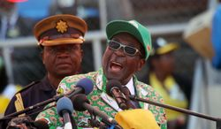 Zimbabwean President Robert Mugabe addresses supporters at his last campaign rally in Harare, Zimbabwe, on Sunday, July 28, 2013. Mr. Mugabe, who has been in power for 33 years, is seeking another term in elections Wednesday. (AP Photo/Str)