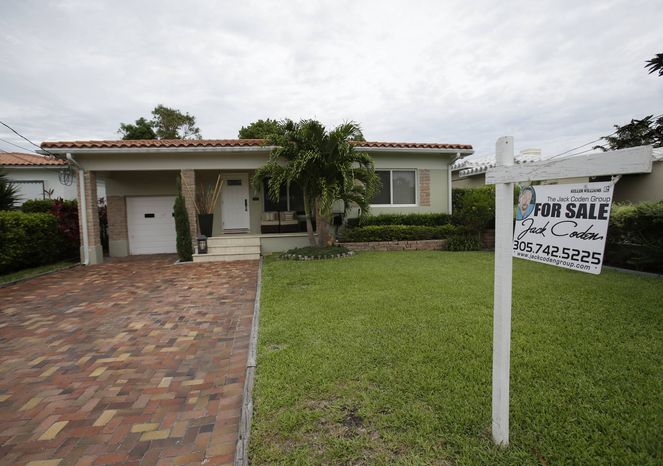 ** FILE ** In this Tuesday, May 28, 2013, photo, a single family home is shown for sale in Surfside, Fla. (AP Photo/W