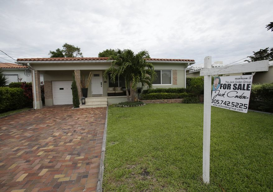 ** FILE ** In this Tuesday, May 28, 2013, photo, a single family home is shown for sale in Surfside, Fla. (AP Photo/Wilfredo Lee)