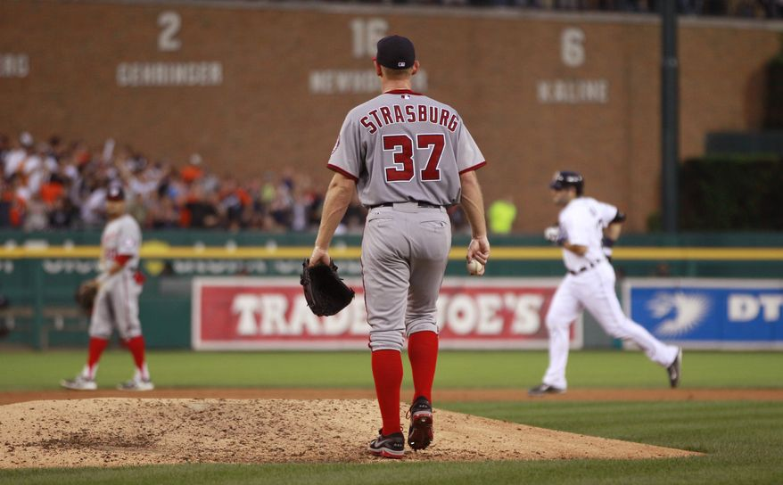 Washington Nationals' pitcher Stephen Strasburg makes his way back to the mound as Detroit Tigers catcher Alex Avila rounds the bases following his sixth-inning grand slam on Tuesday night. (Associated Press photo)