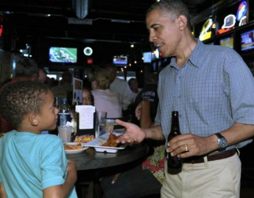 ** FILE ** President Obama talks with a child in Amherst, Ohio, July 12, 2012.