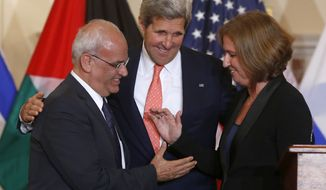 Secretary of State John Kerry stands between Israel's Justice Minister and chief negotiator Tzipi Livni (right) and Palestinian chief negotiator Saeb Erekat as they shake hands after the resumption of Israeli-Palestinian peace talks on July 30, 2013, at the State Department in Washington. (Associated Press)