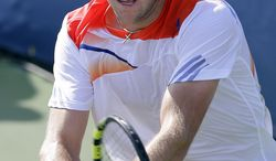 Jack Sock hits the ball during his match against Igor Sijsling, from the Netherlands, at the Citi Open tennis tournament, Tuesday, July 30, 2013 in Washington. Sock won 6-4, 6-2. (AP Photo/Alex Brandon)