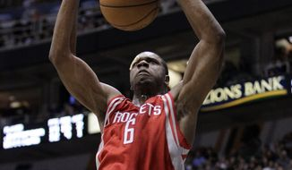 **FILE** Houston Rockets power forward Terrence Jones (6) dunks the ball in the fourth quarter during an NBA basketball game with the Utah Jazz Monday, Nov. 19, 2012, in Salt Lake City. (AP Photo/Rick Bowmer)