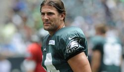 """In this Sunday, July 28, 2013, photo, Philadelphia Eagles wide receiver Riley Cooper pauses during the NFL football team's training camp in Philadelphia. Cooper has been fined by the team for making a racial slur at a Kenny Chesney concert that was caught on video, leading him to say he's """"ashamed and disgusted"""" with himself. The video of Cooper making the slur surfaced Wednesday, July 31, on the Internet. (AP Photo/Michael Perez)"""