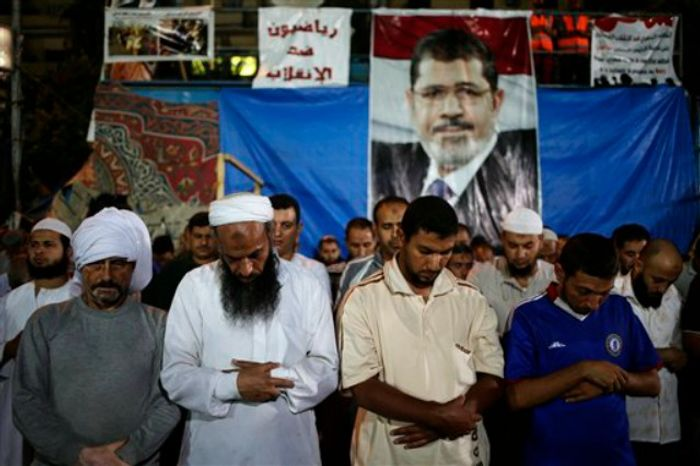 Supporters of Egypt's ousted President Mohammed Morsi pray outside Rabaah al-Adawiya mosque, where supporters of Egypt's ousted President Mohammed Morsi have installed a camp and hold daily rallies at Nasr City, in Cairo, Egypt, late Tuesday, July 30, 2013. (Associated Press)