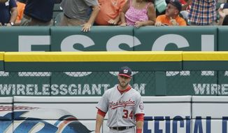 Washington Nationals left fielder Bryce Harper stands in the outfield as fans celebrate the solo home run by Detroit Tigers' Torii Hunter during the second inning of a baseball game in Detroit, Wednesday, July 31, 2013. (AP Photo/Carlos Osorio)