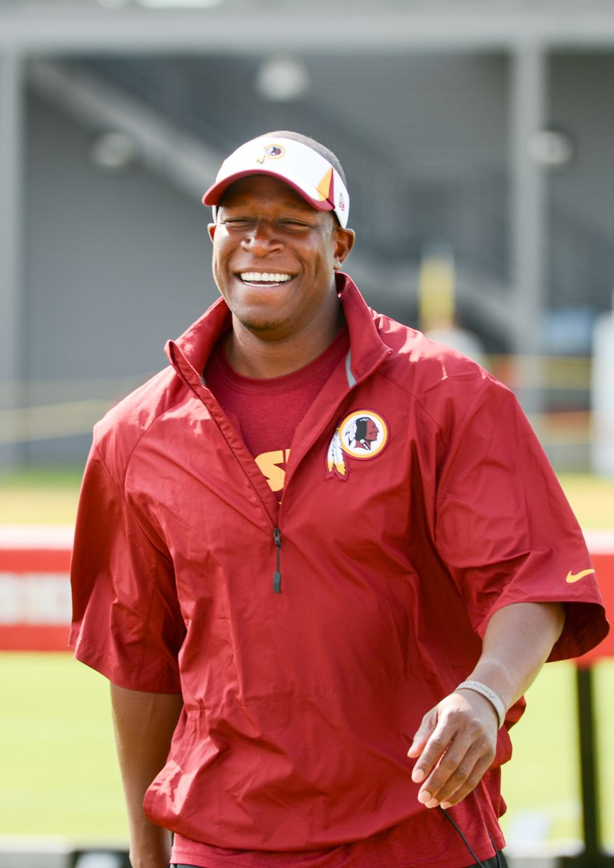 Washington Redskins defensive backs coach Raheem Morris arrives for morning walkthroughs at the Bon Secours Washington Redskins Training Center, Richmond, Va., Tuesday, July 30, 2013. (Andrew Harnik/The Washington Times)