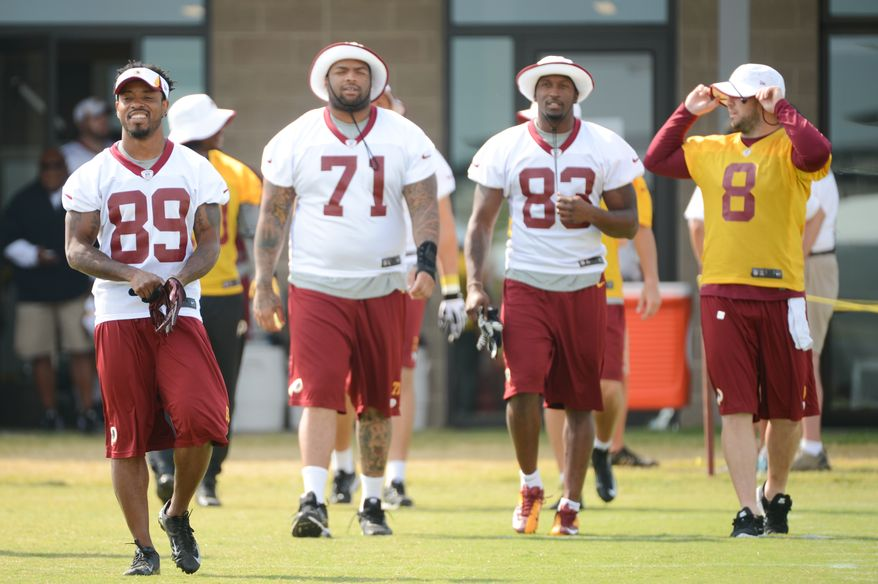 Left to right: Washington Redskins wide receiver Santana Moss (89), Washington Redskins tackle Trent Williams (71), Washington Redskins tight end Fred Davis (83), and Washington Redskins quarterback Rex Grossman (8) arrive for morning walkthroughs at the Bon Secours Washington Redskins Training Center, Richmond, Va., Tuesday, July 30, 2013. (Andrew Harnik/The Washington Times)