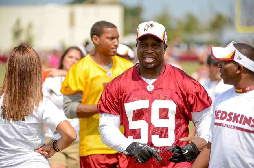 Washington Redskins inside linebacker London Fletcher (59) comes off the field after morning walkthroughs at the Bon Secours Washington Redskins Training Center, Richmond, Va., Tuesday, July 30, 2013. (Andrew Harnik/The Washington Times)