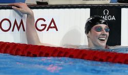 United States's Missy Franklin smiles after winning the gold medal in the Women's 200m freestyle final at the FINA Swimming World Championships in Barcelona, Spain, Wednesday, July 31, 2013. (AP Photo/Michael Sohn)