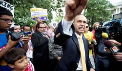 Democratic Reps. Luis V. Gutierrez (foreground) of Illinois and Raul M. Grijalva of Arizona join immigration reform supporters Thursday at a protest on Capitol Hill, marking an escalation in efforts to push for a bill this year that contains a pathway to citizenship. (Associated Press)