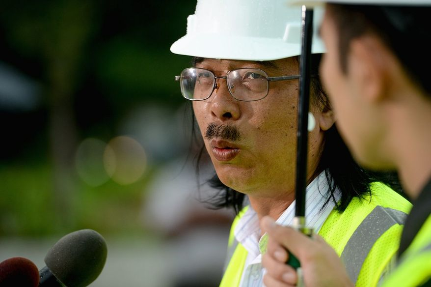 """Chinese sculptor Lei Yixin gives an update Thursday on his work to remove a controversial """"drum major"""" quote off the side of the Martin Luther King Jr. Memorial near the Tidal Basin. (Andrew Harnik/The Washington Times)"""