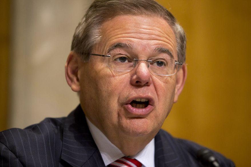 **FILE** Sen. Robert Menendez, New Jersey Democrat and chairman of the Senate Foreign Relations Committee, speaks during a committee hearing on Embassy Security on Capitol Hill in Washington on July 16, 2013. (Associated Press)