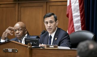 Rep. Darrell Issa, California Republican and chairman of the House Oversight and Government Reform Committee, discusses a plan July 24, 2013, on Capitol Hill to move mail to cluster box and curbside delivery in a move to cut costs at the cash-strapped Postal Service by up to $4.5 billion a year. With the Postal Service facing billions of dollars in annual losses, the tradition of mail delivery to the door could be virtually phased out by 2022 under a proposal in Congress. At left is the committee's ranking Democrat, Rep. Elijah Cummings of Maryland. (Associated Press)