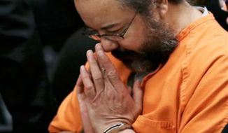 Ariel Castro rubs his nose in the courtroom during the sentencing phase Thursday, Aug. 1, 2013, in Cleveland. Three months after an Ohio woman kicked out part of a door to end nearly a decade of captivity, Castro, a onetime school bus driver faces sentencing for kidnapping three women and subjecting them to years of sexual and physical abuse. (AP Photo/Tony Dejak)