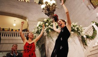 Margaret Miles, right, celebrates with wife Cathy ten Broeke, left, after they were married at the Minneapolis Freedom to Marry Celebration, Thursday, Aug. 1, 2013 at the Minneapolis City Hall. The couple were the first women legally married in Minnesota. (AP Photo/Stacy Bengs)