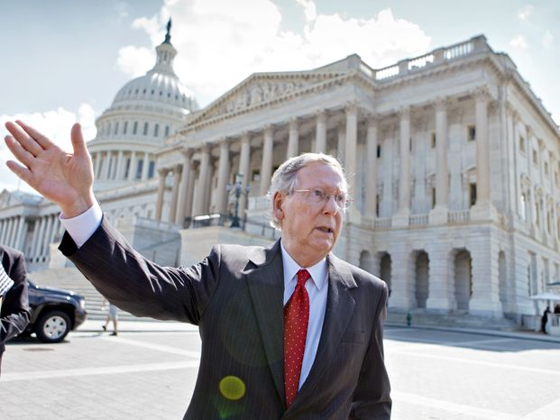 Senate Minority Leader Mitch McConnell, R-Ky., waits for the arrival of the University of Louisville men's basketball team being honored for their 2013 NCAA championship, on Capitol Hill in Washington, Tuesday, July 23, 2013. (AP Photo/J. Scott Applewhite)