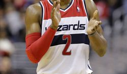 FILE - In this March 25, 2013, file photo, Washington Wizards guard John Wall (2) celebrates in the second half of an NBA basketball game against the Memphis Grizzlies in Washington.  (AP Photo/Alex Brandon, File)