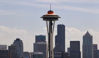 "** FILE ** The top of the Space Needle sports a new coat of orange, called ""galaxy gold"" when it first appeared 50 years ago atop the structure, as part of the landmark's 50th anniversary celebration on April 23, 2012, in Seattle. (Associated Press)"