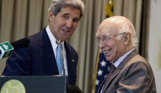 Sartaj Aziz, right, Pakistan's special adviser on national security and foreign affairs, interacts with U.S. Secretary of State John Kerry after their press conference in Islamabad, Pakistan, on Thursday, Aug. 1, 2013. (AP Photo/B.K. Bangash)