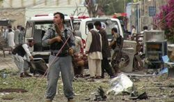 Security officials conduct investigation at the scene of suicide bomb attacks in Jalalabad, Afghanistan, Saturday, 3, 2013. Three suicide attackers killed at least nine civilians, most of them children, in a botched attack Saturday on the Indian consulate in an eastern Afghan city near the border with Pakistan, security officials said. (Associated Press)