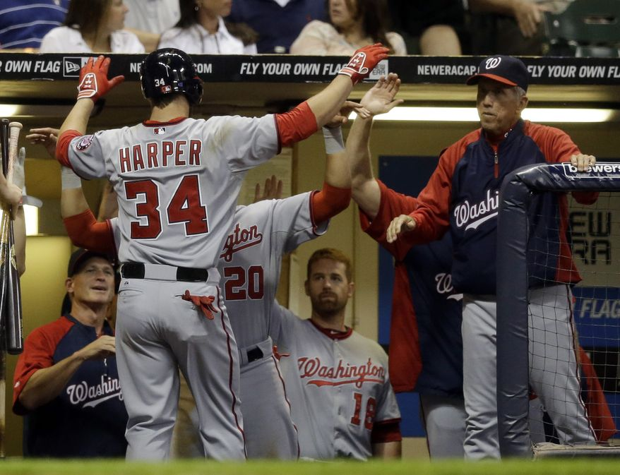 Washington Nationals outfielder Bryce Harper returns to the dugout at Miller Park after clubbing his 16th home run of the season in the Nationals' 4-1 win over the Milwaukee Brewers. (Associated Press photo)