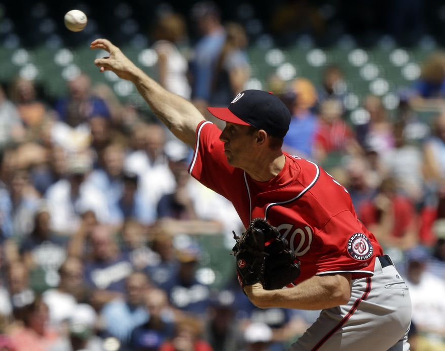 Washington Nationals right-hander Taylor Jordan throws during a game against the Milwaukee Brewers. (Associated Press photo)