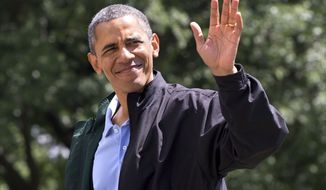President Barack Obama waves to the media as he walks on the South Lawn of the White House in Washington after returning on Marine One from Camp David, Md., where he spent his birthday Sunday, Aug. 4, 2013. (AP Photo/Jacquelyn Martin)
