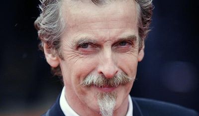 """** FILE ** Glasgow-born actor and Oscar winner Peter Capaldi, as he appeared in London in this file photo dated May 12, 2013. Peter Capaldi was named late Sunday Aug. 4, 2013, as the next lead star for the long-running British science fiction TV series """"Doctor Who."""" (AP Photo / Dominic Lipinski, PA, FILE)"""