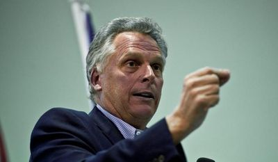 ** FILE ** Terry McAuliffe speaks during the Falls Church City Democratic Committee fundraising dinner at the Falls Church Community Center, in Falls Church, Va., Sunday, April 3, 2011. (Drew Angerer/The Washington Times)