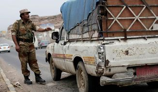 A Yemeni soldier stops a car at a checkpoint on a street leading to the U.S. Embassy in Sanaa on Sunday. (Associated Press)