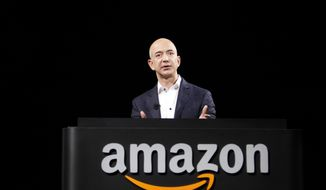 **FILE** Jeff Bezos, CEO and founder of Amazon, speaks at the introduction of the new Amazon Kindle Fire HD and Kindle Paperwhite personal devices, in Santa Monica, Calif., on Sept. 6, 2012. (Associated Press)