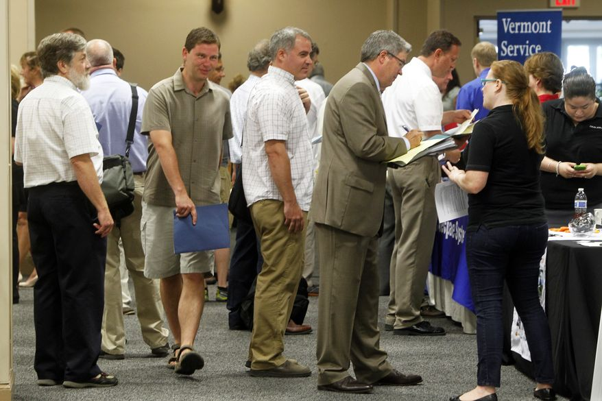 **FILE** People line up at the job fair in South Burlington, Vt., on  July 15, 2013. (Associated Press)