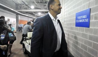 New York Yankees' Alex Rodriguez arrives at U.S. Cellular Field before an MLB baseball game between the Chicago White Sox and New York Yankees in Chicago, Monday, Aug. 5, 2013. (AP Photo/Paul Beaty