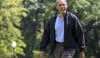 **FILE** President Obama walks across the South Lawn of the White House after returning from Camp David in Washington on Aug. 4, 2013, his 52nd birthday . (Associated Press)
