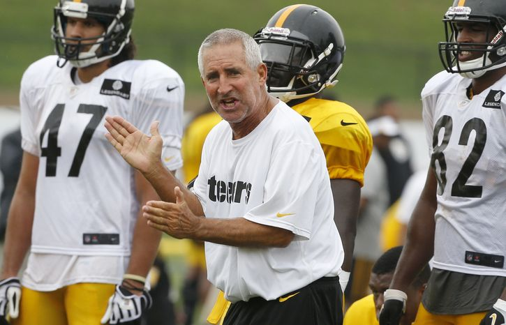 In this photo from July 31, 2013, new Pittsburgh Steelers special teams coach Danny Smith, center, claps as he supervises drills at the team training facility in Latrobe, Pa. Pittsburgh hired Smith in the offseason after he spent nearly a decade in the same position with the Washington Redskins. (AP Photo/Keith Srakocic)