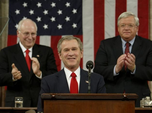 President Bush is applauded by Vice President Dick Cheney (left) and House Speaker Dennis Hastert, of Ill. while delivering his State of the Union address to a joint session of Congress in 2004. (Associated Press)