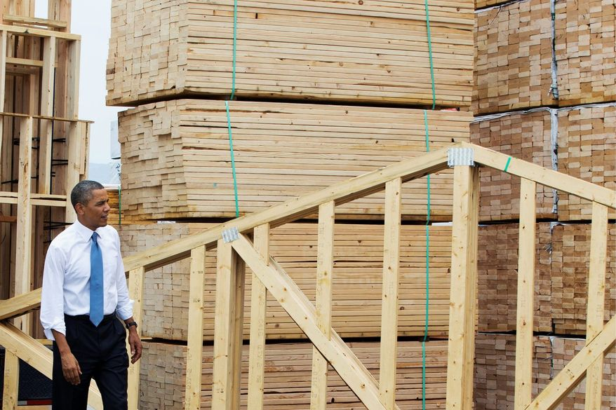 President Obama tours the home framing assembly area at Erickson Construction in Chandler, Ariz., on Tuesday. Mr. Obama annouced support of a Senate bill that would eliminate mortgage giants Fannie Mae and Freddie Mac. (Associated Press)