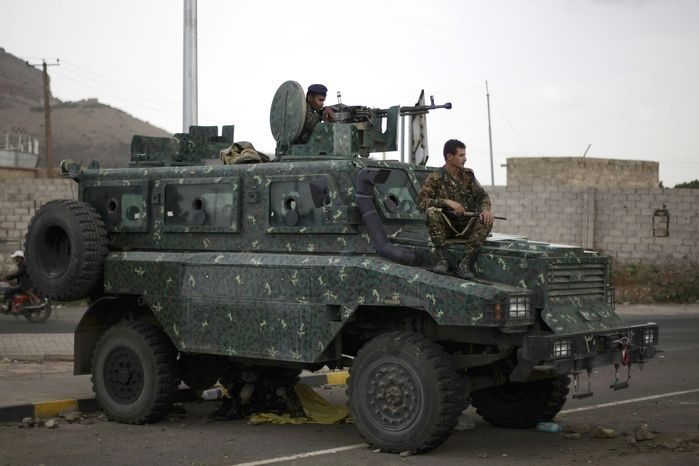Police in an armored vehicle secure a road leading to the U.S. embassy in Sanaa, Yemen, on Aug. 6, 2013. The State Department ordered non-essential personnel at the U.S. Embassy in Yemen to leave the country. (Associated Press)