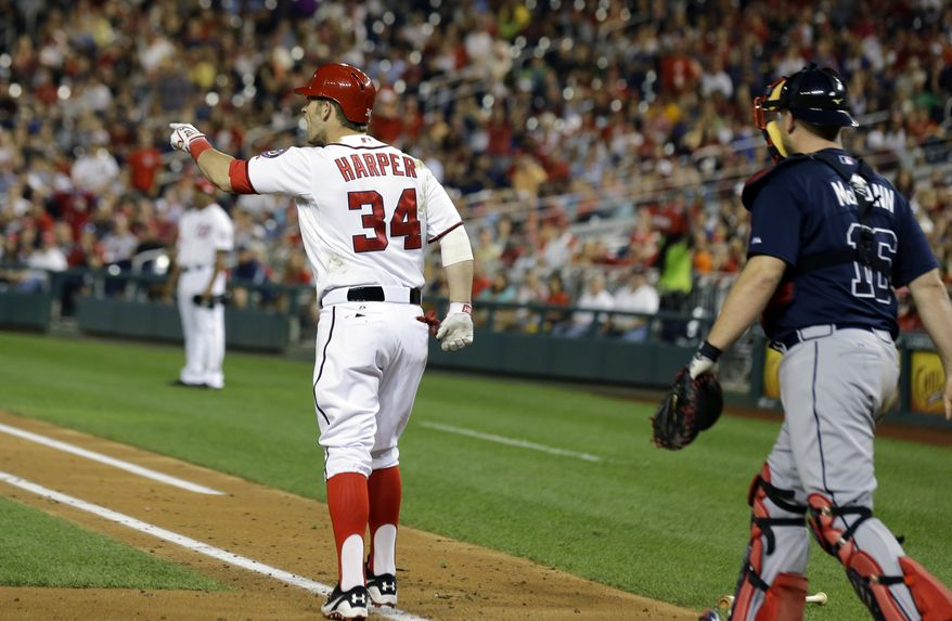 Washington Nationals outfielder Bryce Harper jaws at Atlanta Braves pitcher Julio Teheran after he was hit with a pitch in the fifth inning Tuesday night. (Associated Press photo)