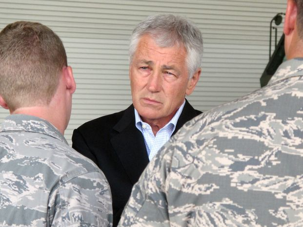 **FILE** Defense Secretary Chuck Hagel talks with Air Force personnel at Joint Base Charleston near Charleston, S.C., on July 17, 2013, the last day of a three-day trip to visit bases in the Carolinas and Florida. (Associated Press)