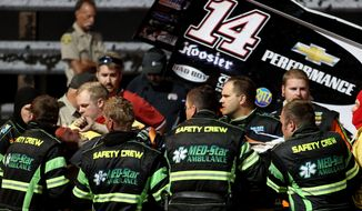 In this Aug. 5, 2013 photo, three-time NASCAR champion Tony Stewart, third from left, is loaded into an ambulance after being involved in a four-car wreck at Southern Iowa Speedway in Oskaloosa, Iowa. A spokesman for Stewart said the 42-year-old driver broke his right tibia and fibula and had surgery after he was transported to a local hospital. (AP Photo/The Des Moines Register, Mary Willie)