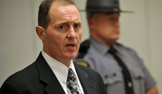 Captain Edward Hoke, Commander of the Pennsylvania State Police Hazleton Barracks speaks at a press conference at the Monroe County Pubic Safety Center on the shooting at the Ross Township Municipal Building that left 3 dead and 3 injured, Monday, Aug. 5, 2013, in Stroudsburg, Pa. Police arrested 59-year-old Rockne Newell. (AP Photo/Chris Post)
