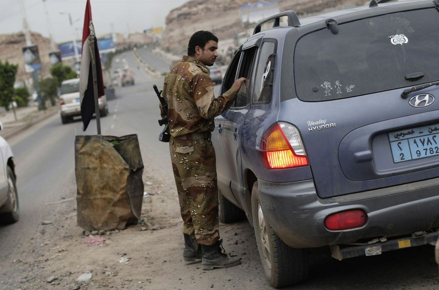 "A Yemeni soldier inspects a car at a checkpoint on a street leading to the U.S. embassy in Sanaa, Yemen, Sunday, Aug. 4, 2013. Security forces close access roads, put up extra blast walls and beef up patrols near some of the 21 U.S. diplomatic missions in the Muslim world that Washington ordered closed for the weekend over a ""significant threat'' of an al Qaeda attack. (AP Photo/Hani Mohammed)"
