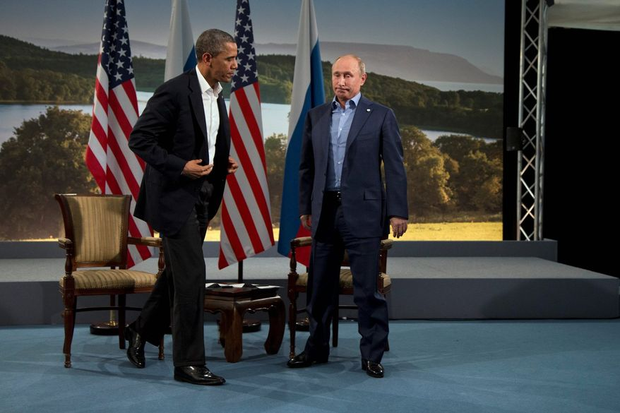 President Obama and Russian President Vladimir Putin met in June in Northern Ireland. Mr. Obama has put off a scheduled meeting in Moscow following Mr. Putin's granting of asylum to NSA leaker Edward Snowden. (Associated Press)