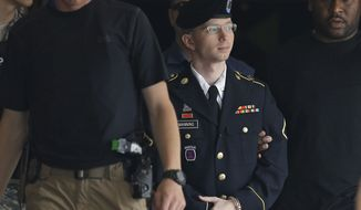 ** FILE ** In this July 30, 2013, file photo, Army Pfc. Bradley Manning is escorted out of a courthouse in Fort Meade, Md., after receiving a verdict in his court martial. A military judge has reduced Army Pfc. Bradley Manning's maximum possible sentence in the WikiLeaks case to 90 years in prison. Judge, Army Col. Denise Lind, found during his sentencing hearing Tuesday, Aug. 6, 2013, that a number of the charges refer to the same actions and therefore were duplicative for sentencing purposes. (AP Photo/Patrick Semansky)